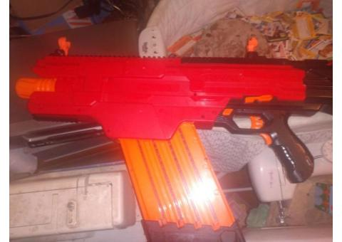 Khaos nerf gun, face mask, and the box of rounds